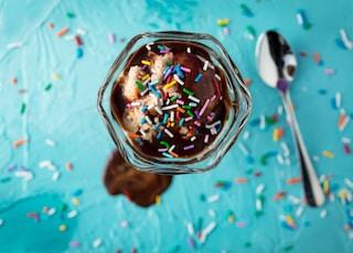 ice cream in glass beside spoon
