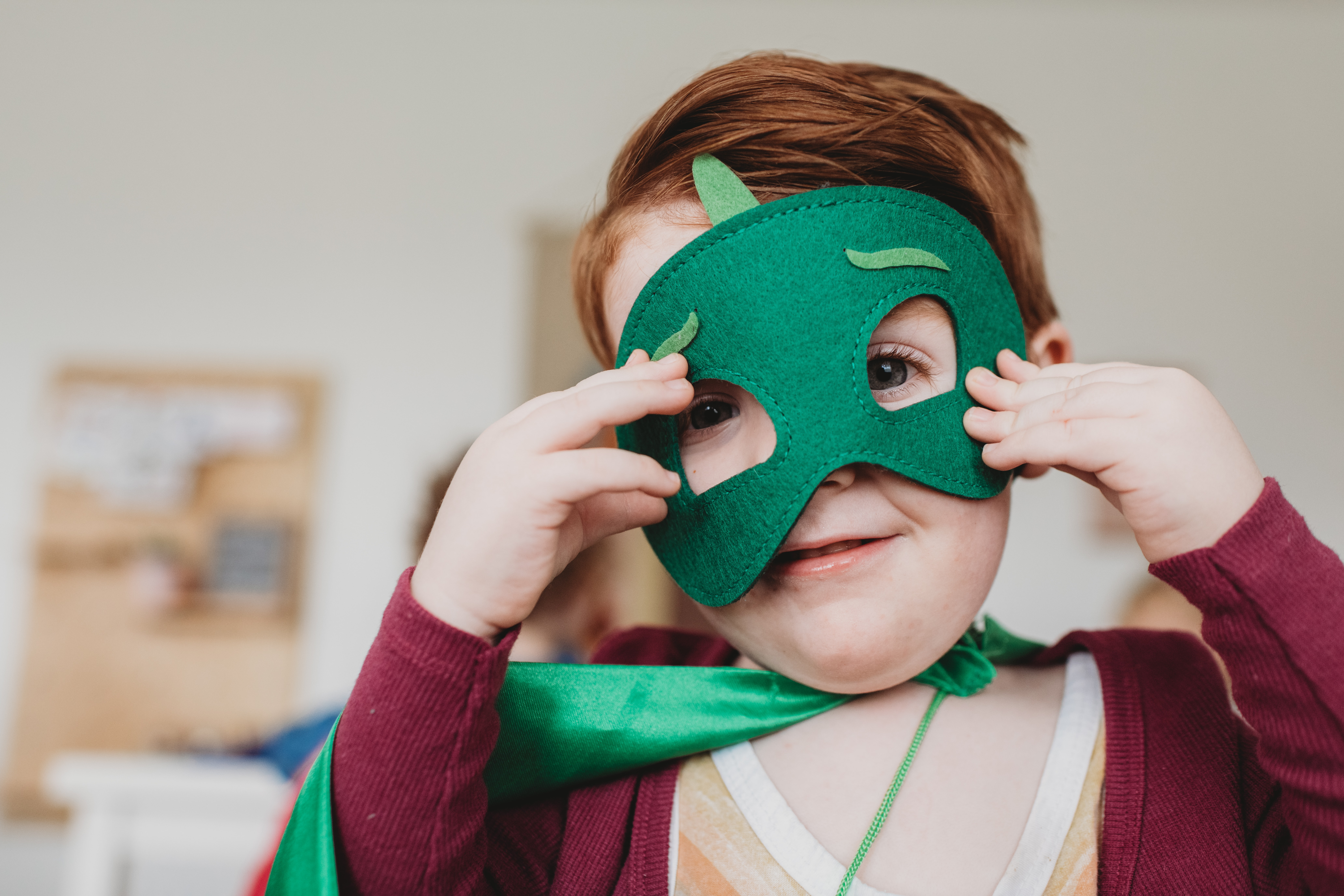 boy holding green mask