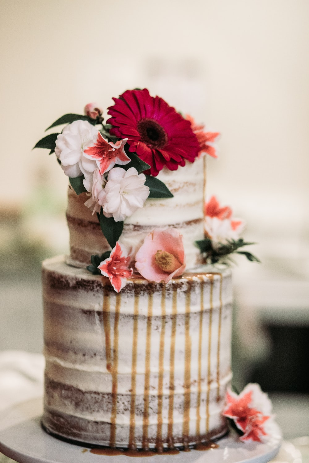 white icing-covered cake with flowers on top