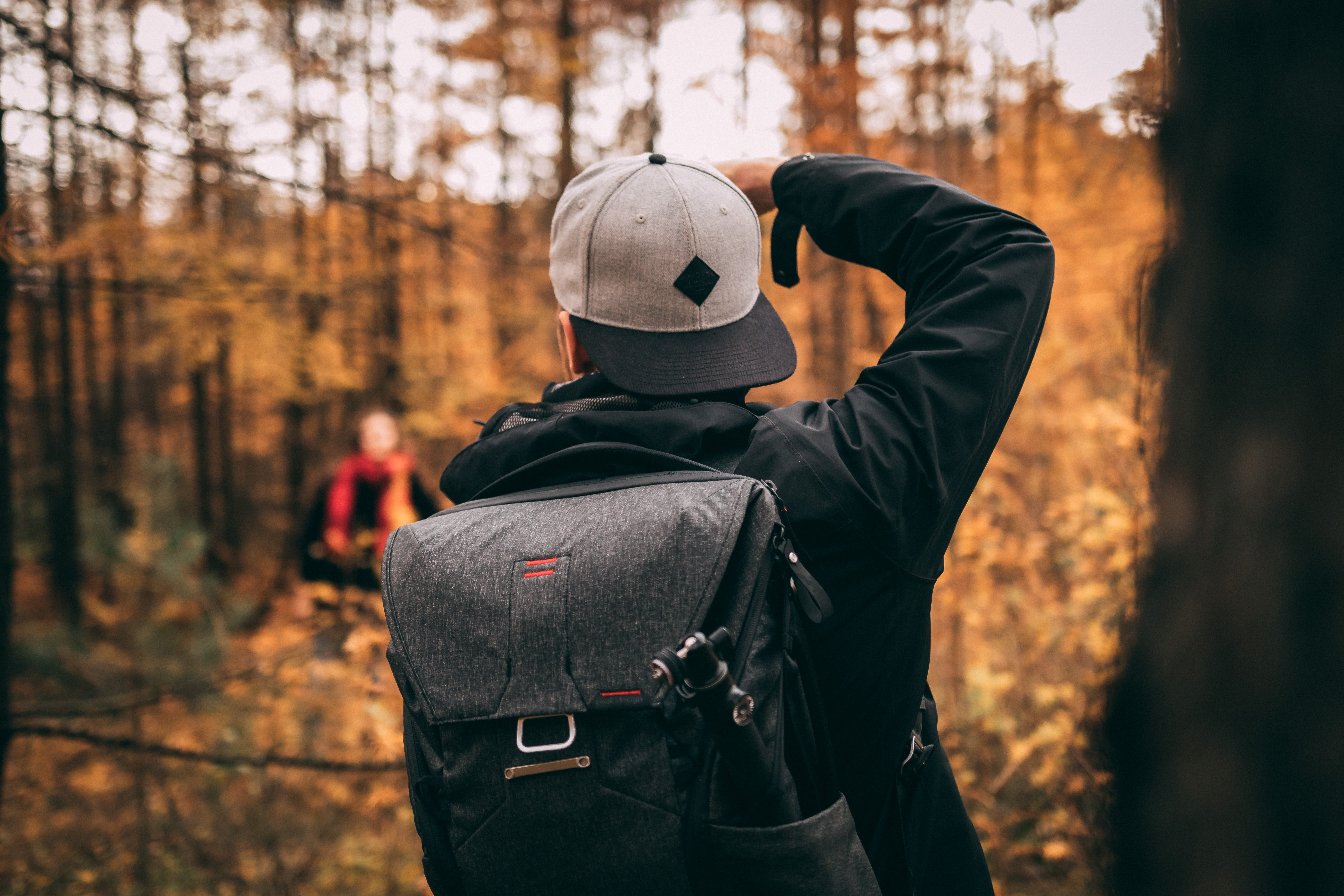 man standing in woods during daytime