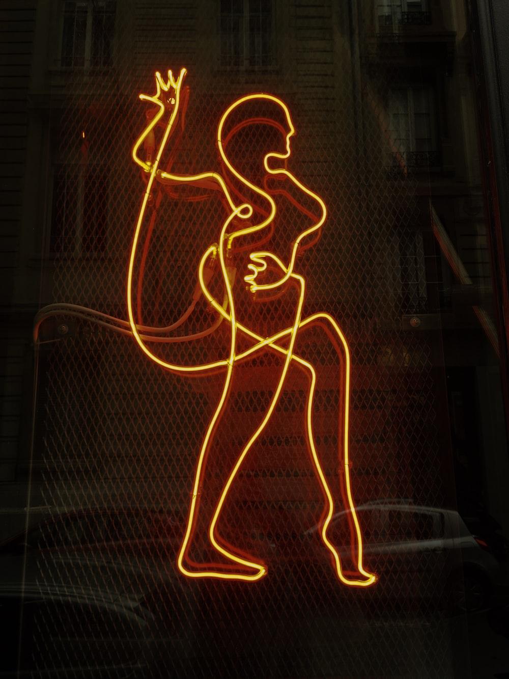 woman neon signage