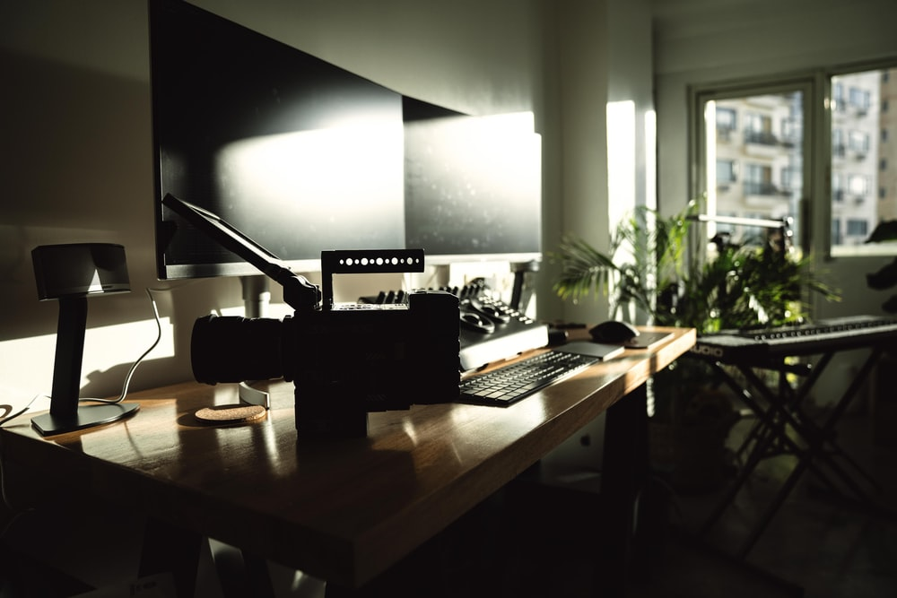 turned-off computer monitors on desk