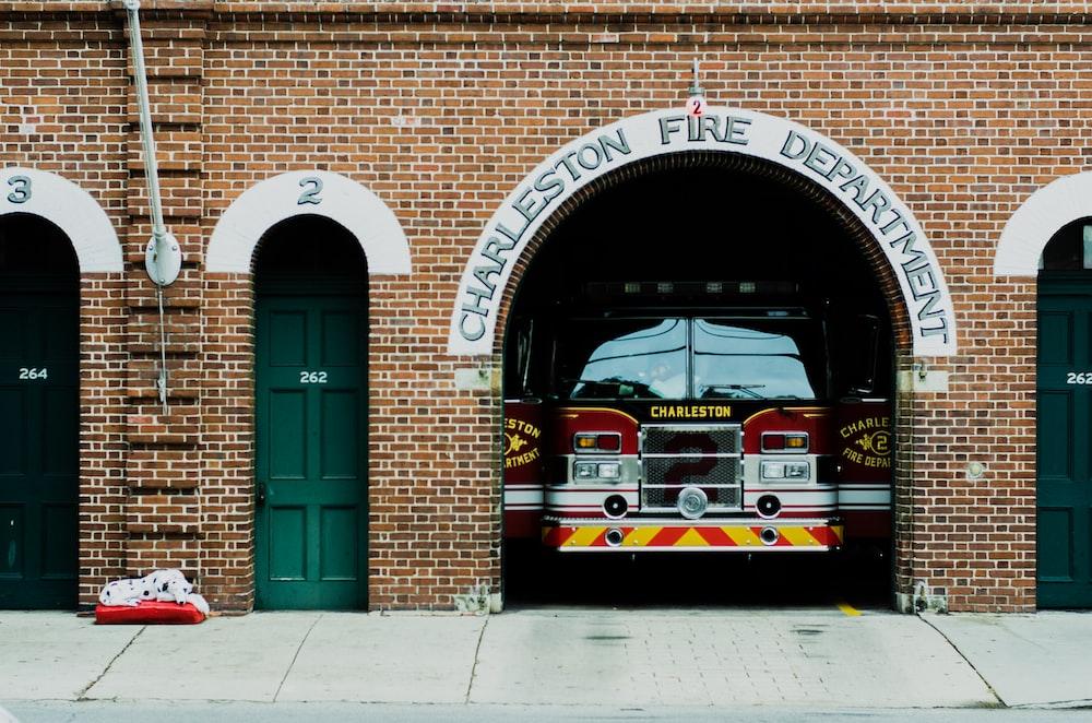 red firetruck under building