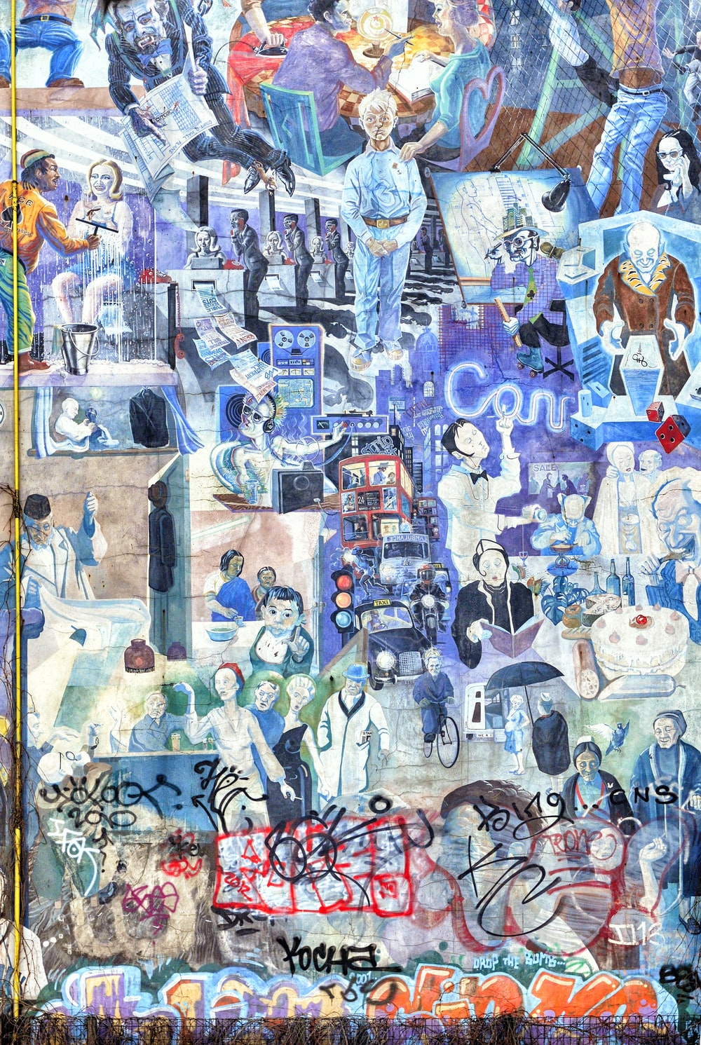 wall with collage graffiti painting