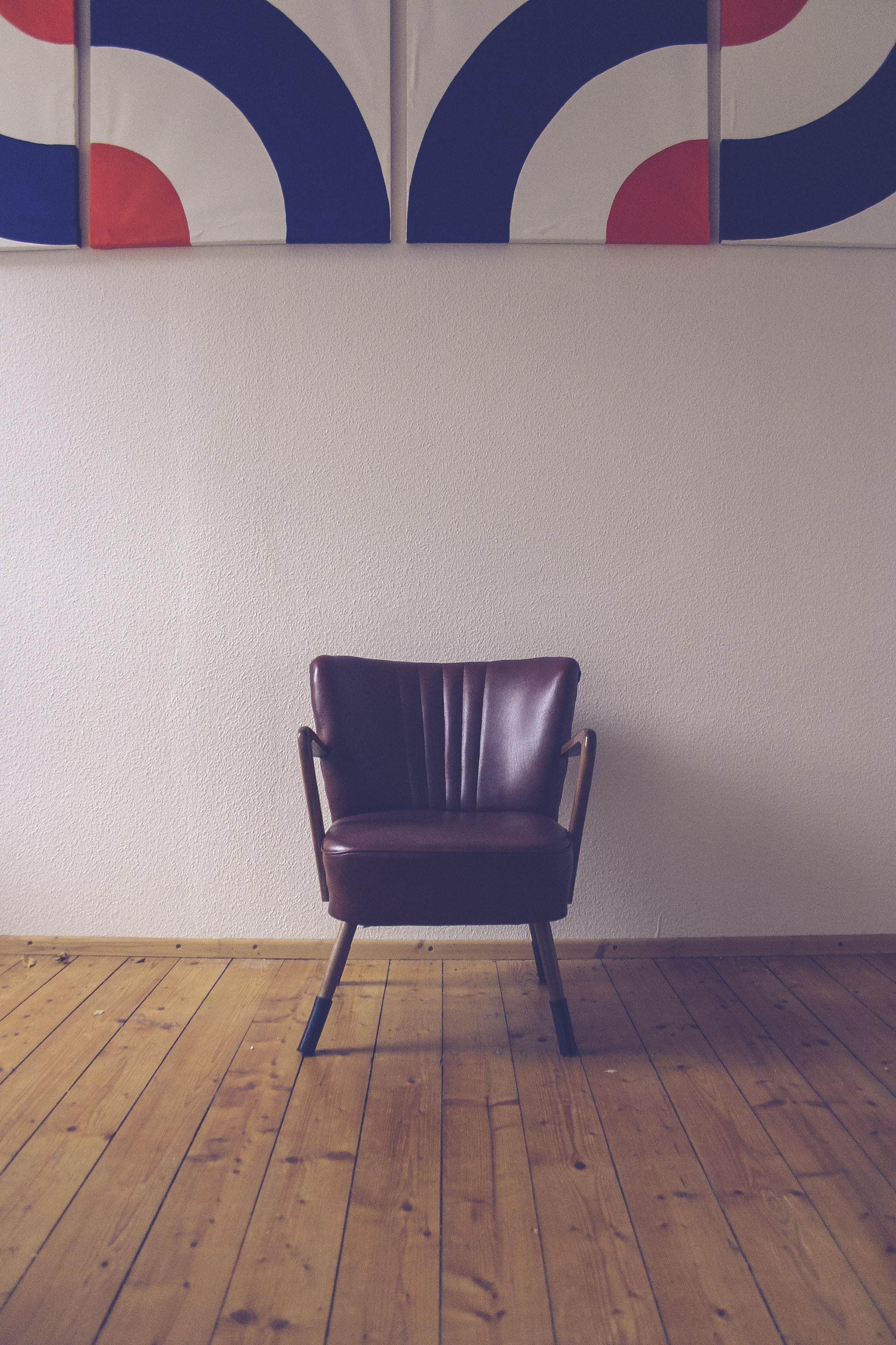 brown leather chair near wall