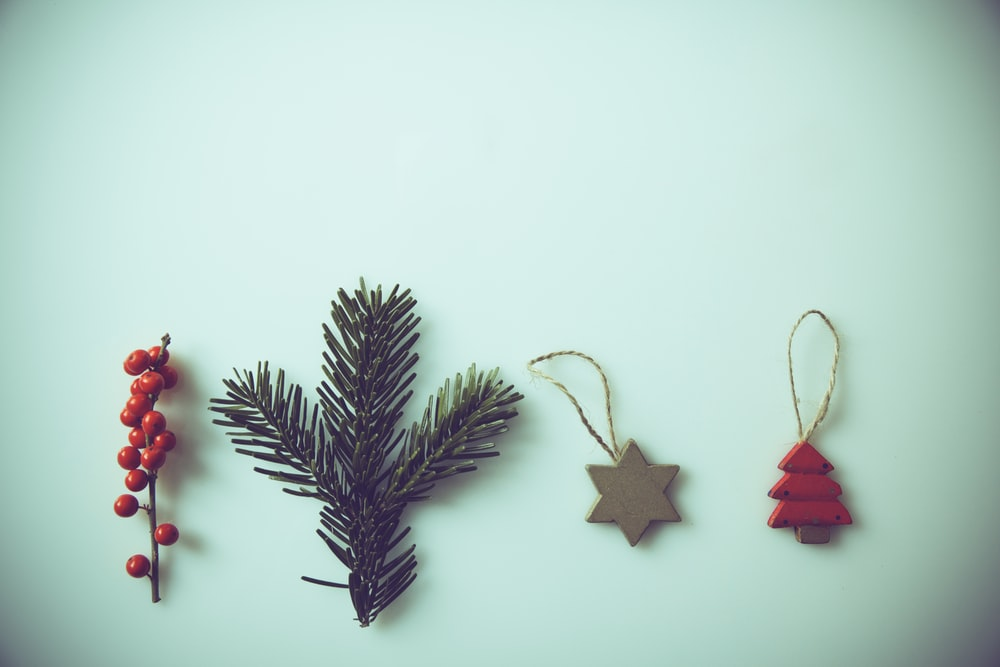 red mistletoe, green pine spruce, and two ornaments