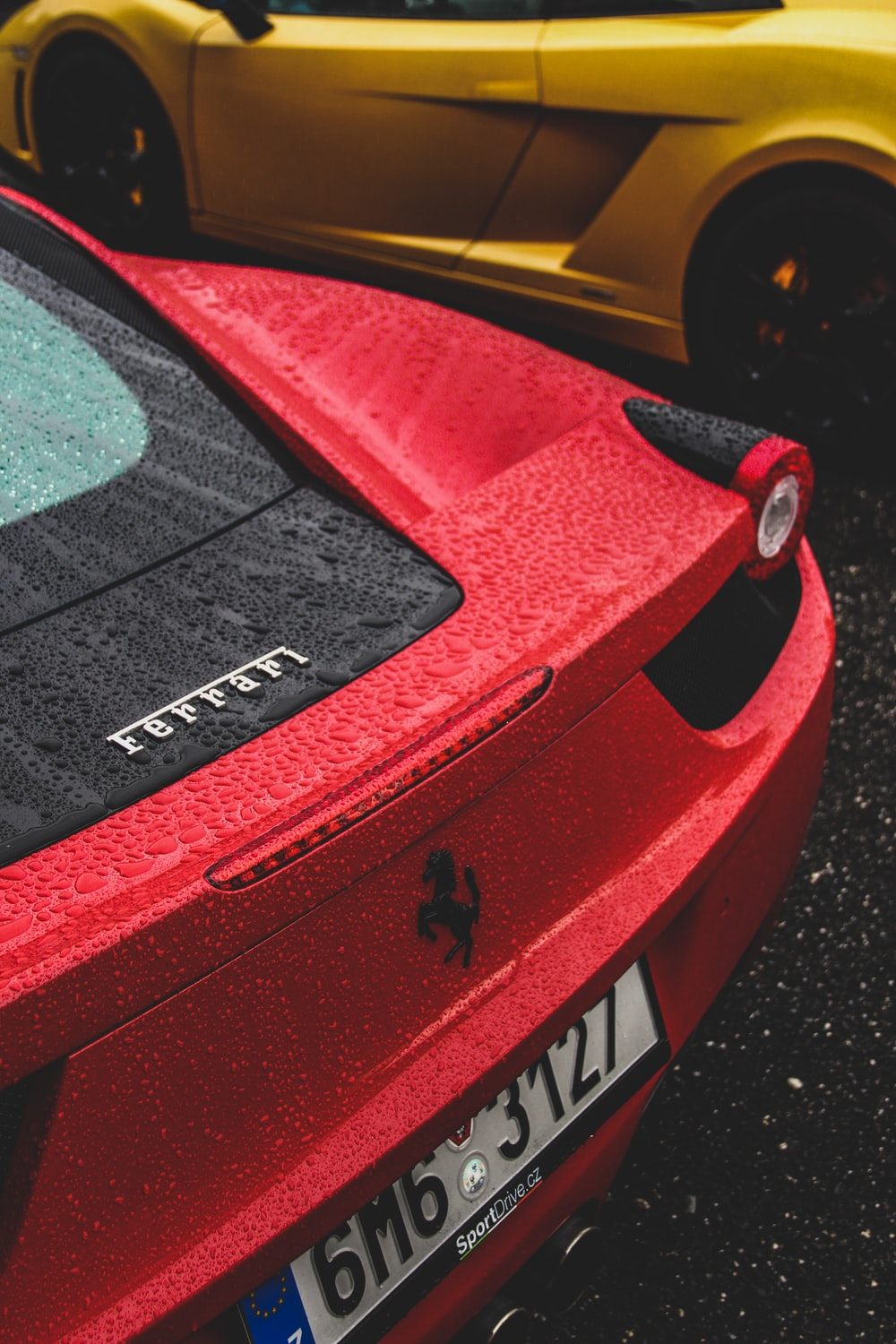 red Ferrari sports car with licence plate number 6M63127