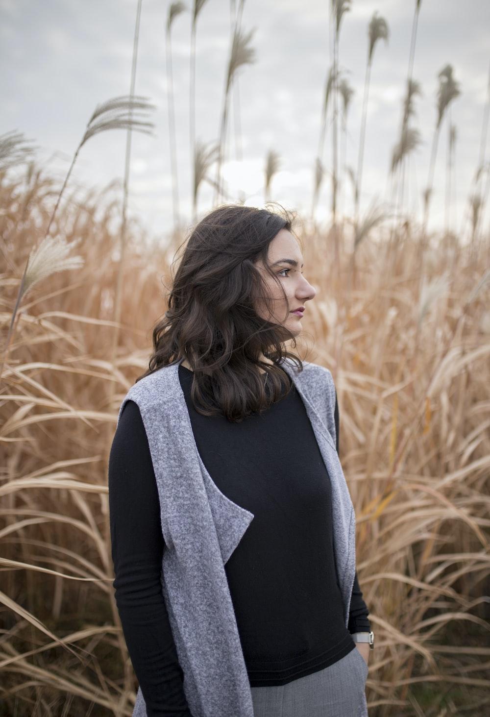 woman standing on brown grass field