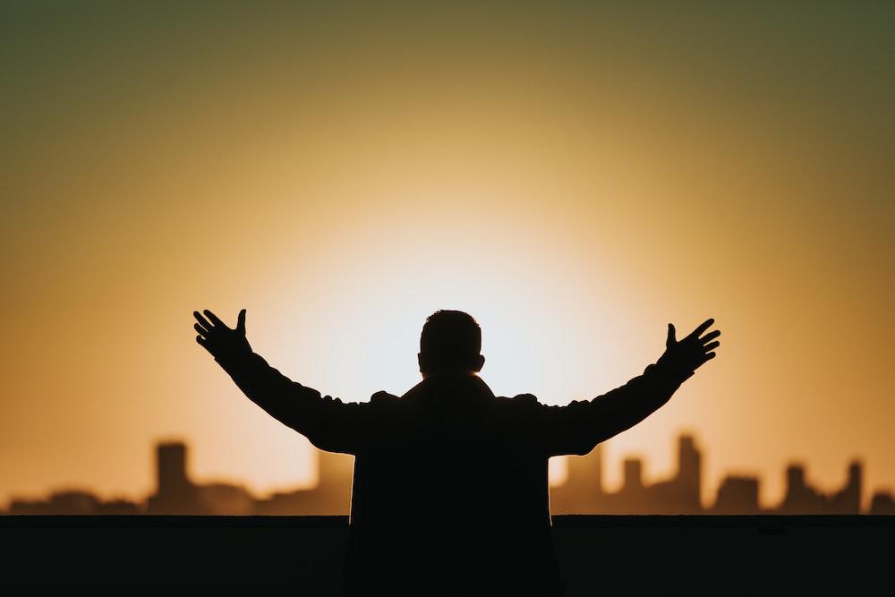 man raising both hands