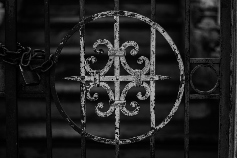 grayscale photography of gate