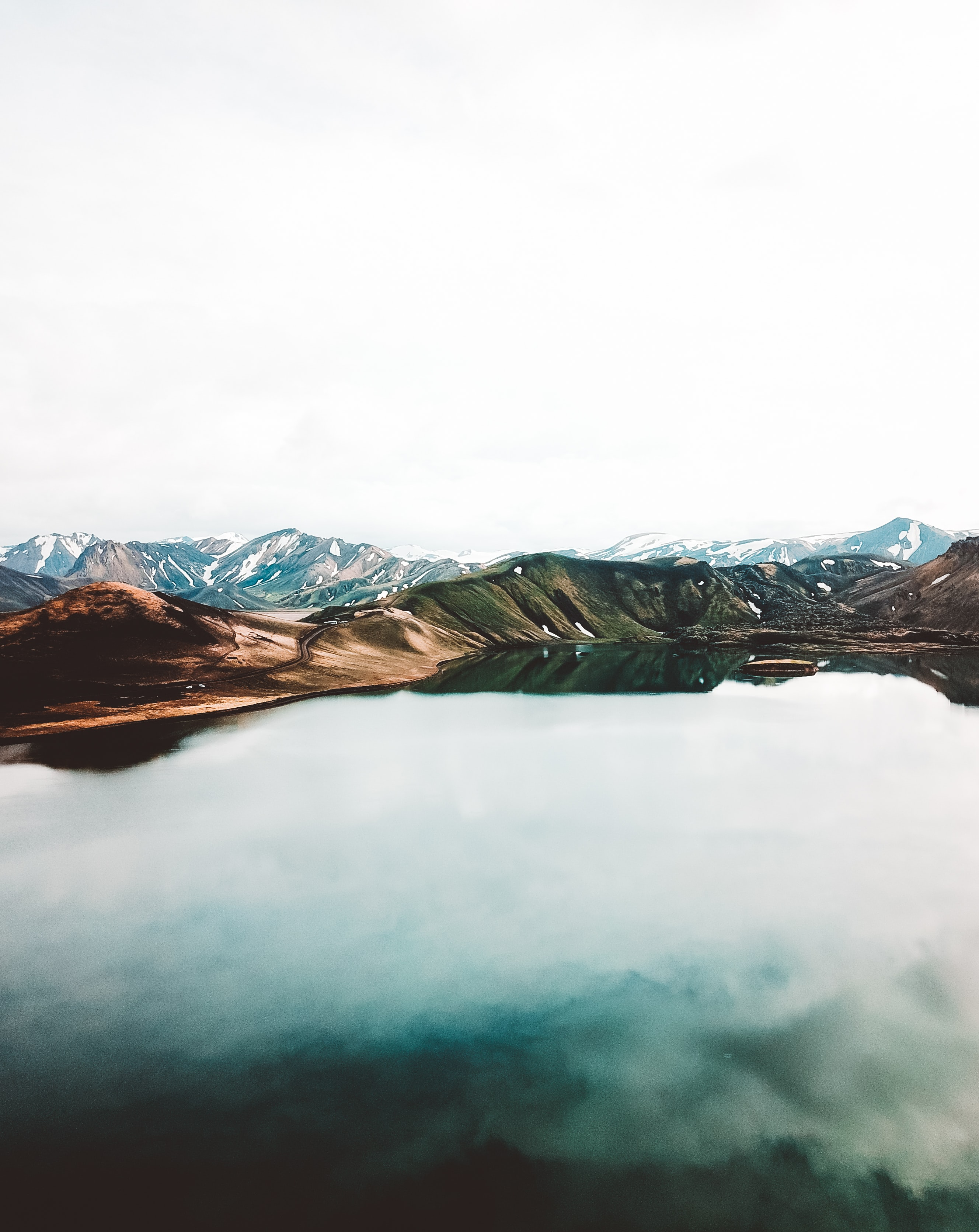 body of water across brown mountain