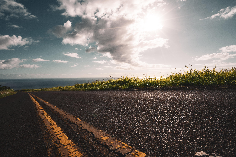 asphalt road under white sky