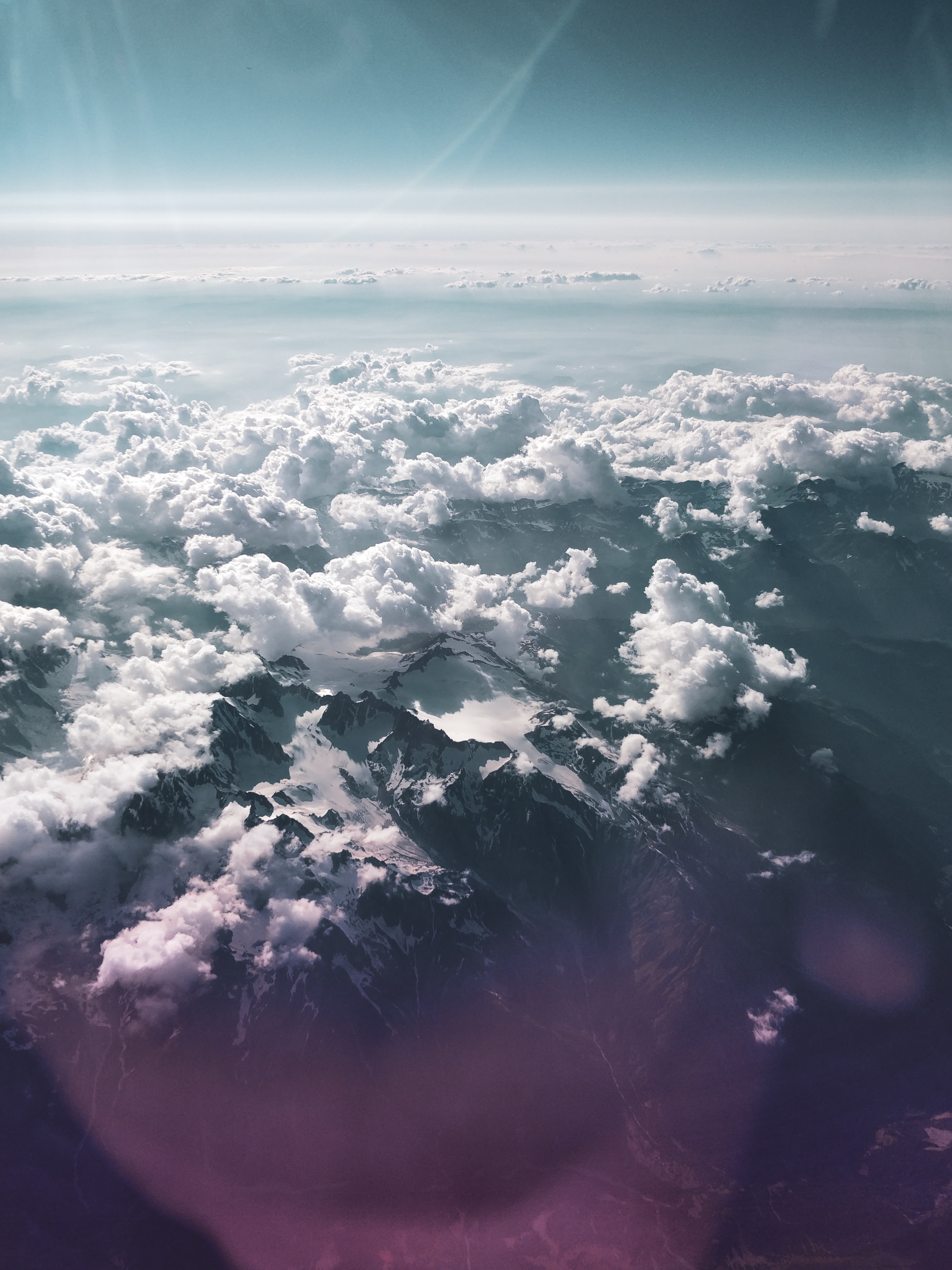 mountain under sea of clouds