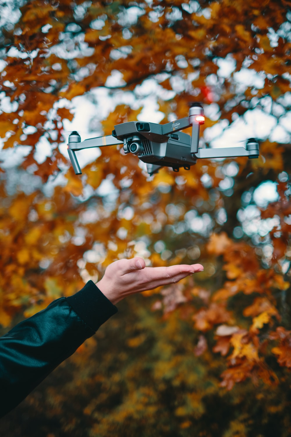 selective focus photography of black drone quadcopter
