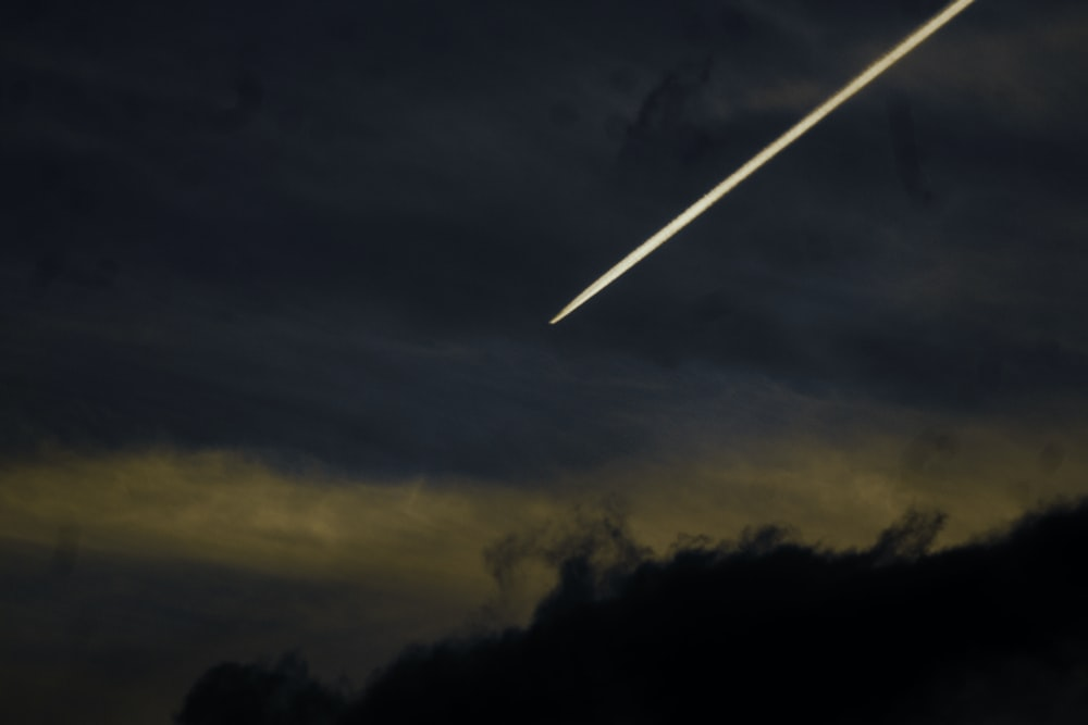 silhouette photography of shooting star