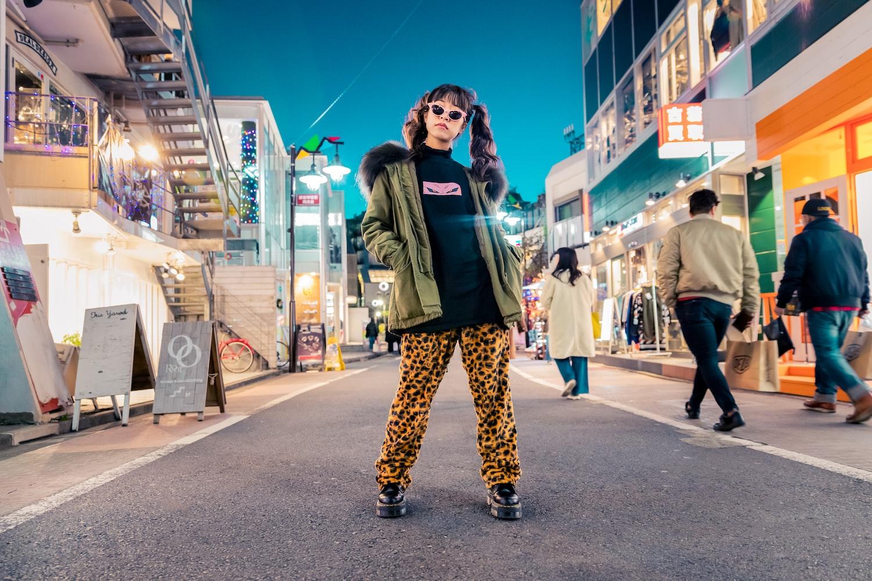 women standing in the street looking modelling