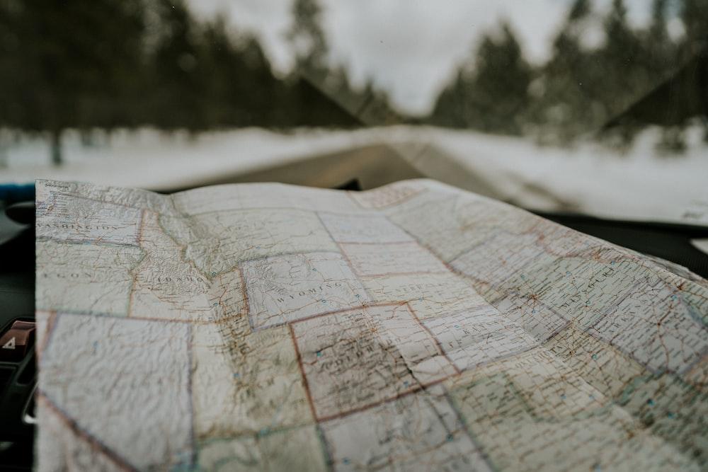 macro photography of map chart inside car