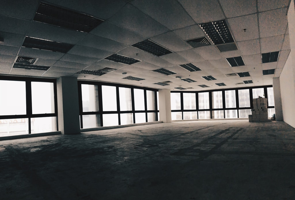 Empty Office Building - Photo by Razlan Hanafiah on Unsplash