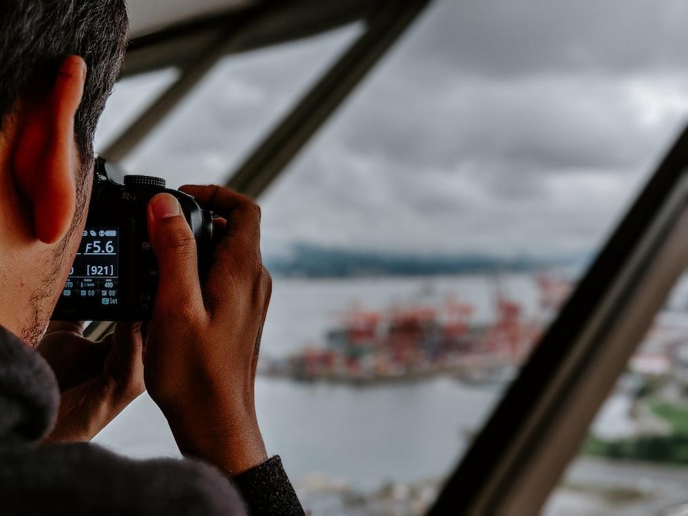 man taking photo of island