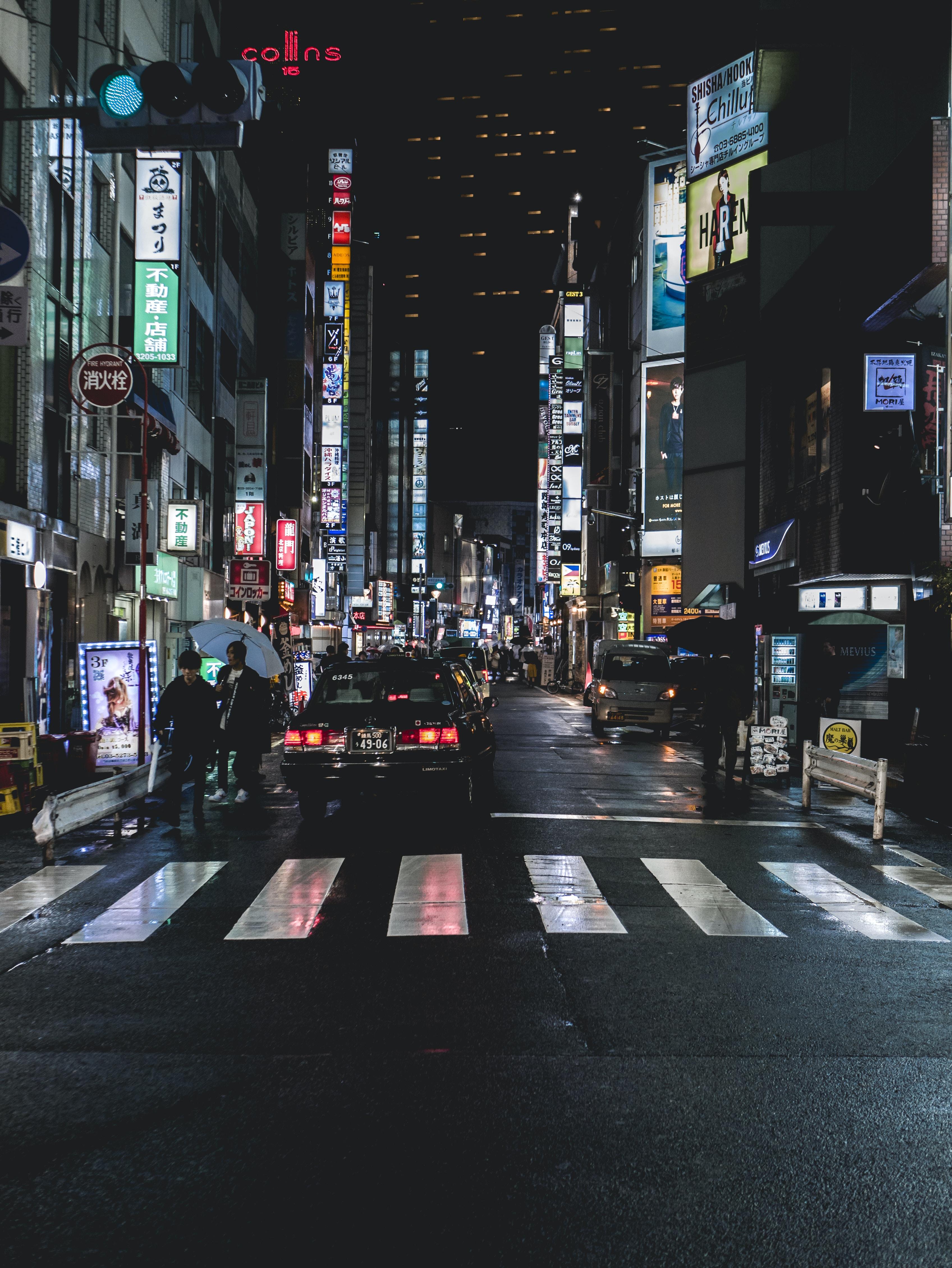 black car on road during nighttime