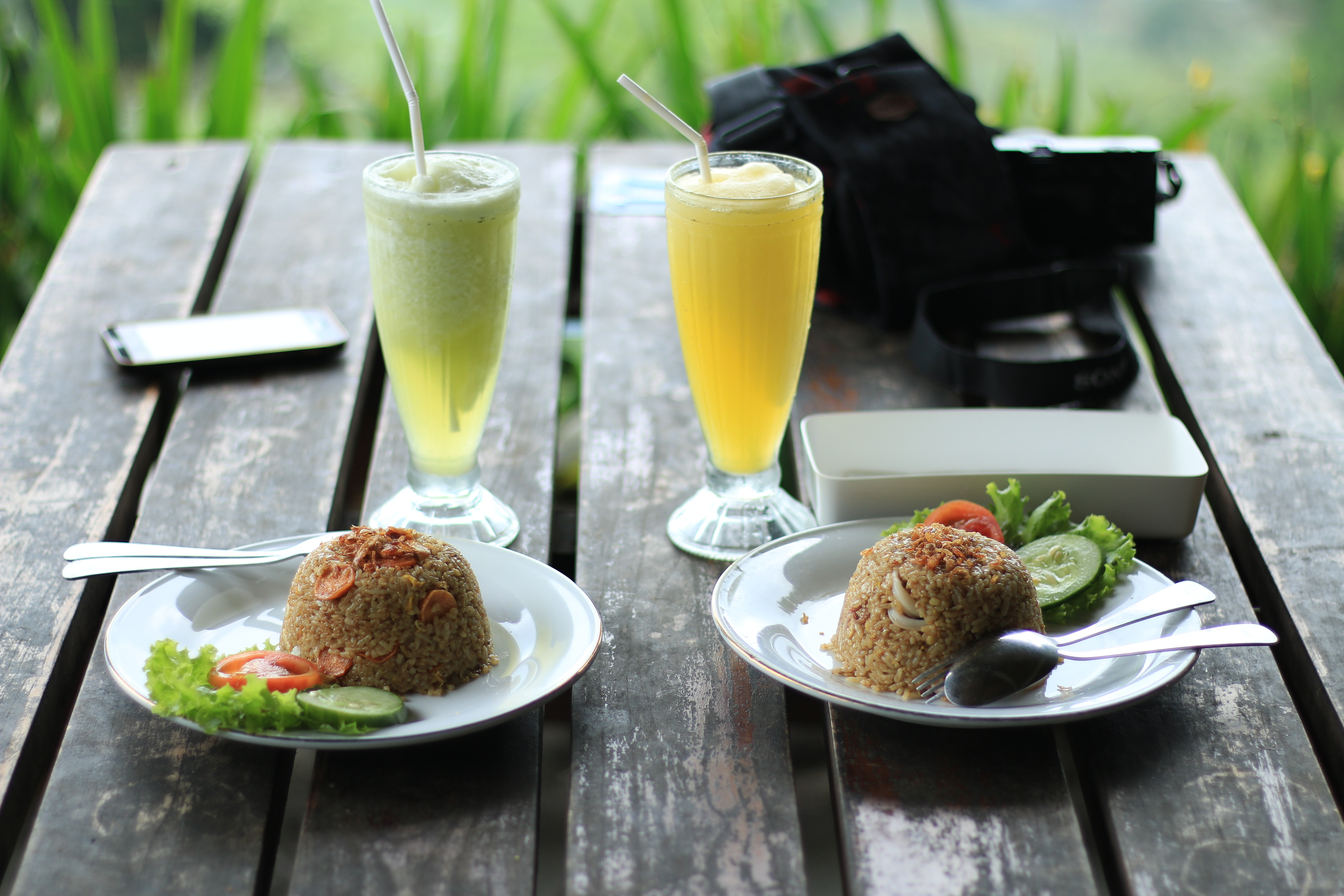 fried rice and glass of juices on table