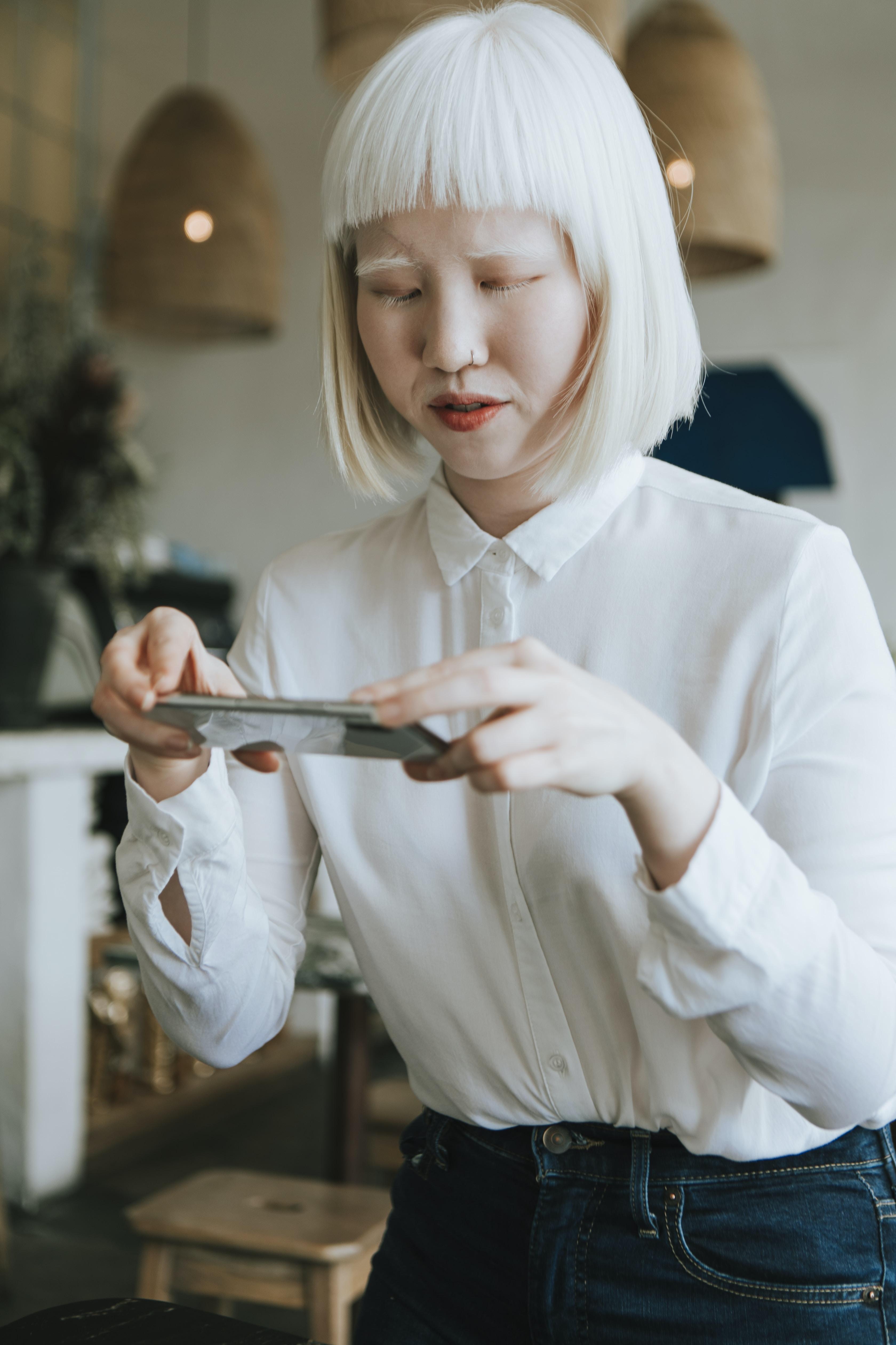 woman holding smartphone taking photo