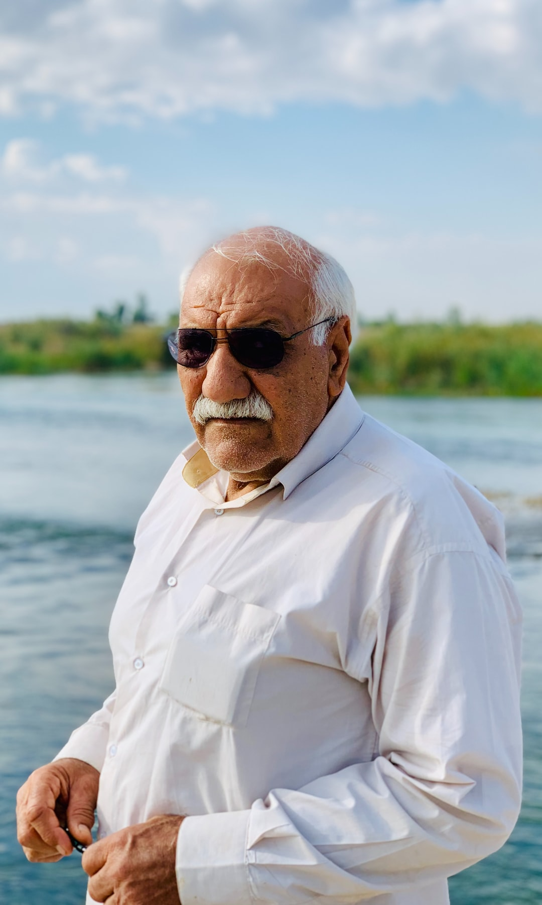 An Old Gentleman, My father  I took a photo from my father on a bridge constructed during the Iran and Iraq war. He works here at that time. If you use the photo, Please note to me@abbasm.com
