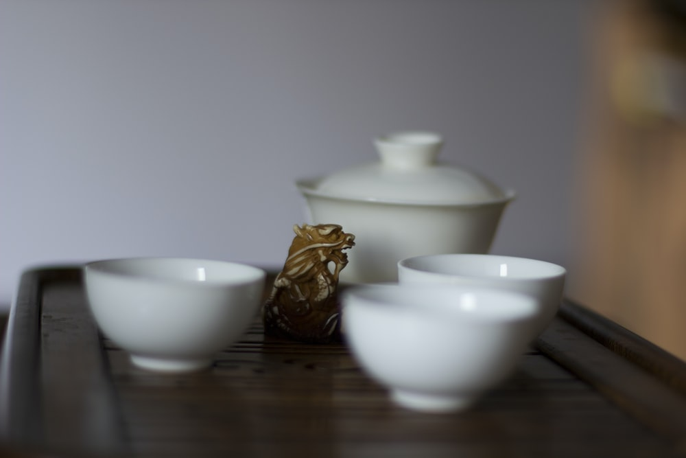 three white ceramic bowls