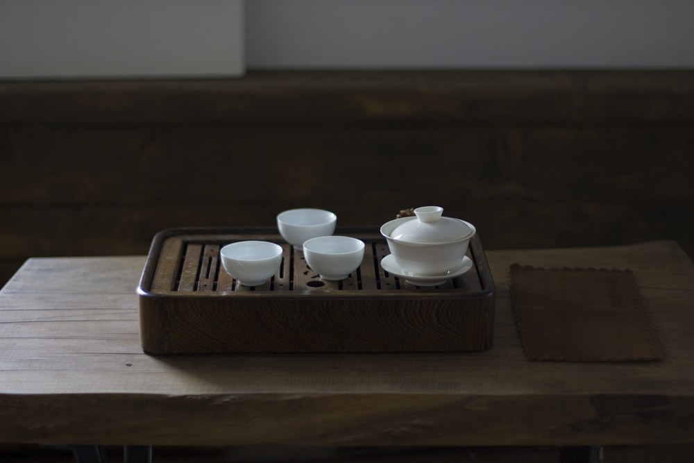 white ceramic bowl on brown wooden tray
