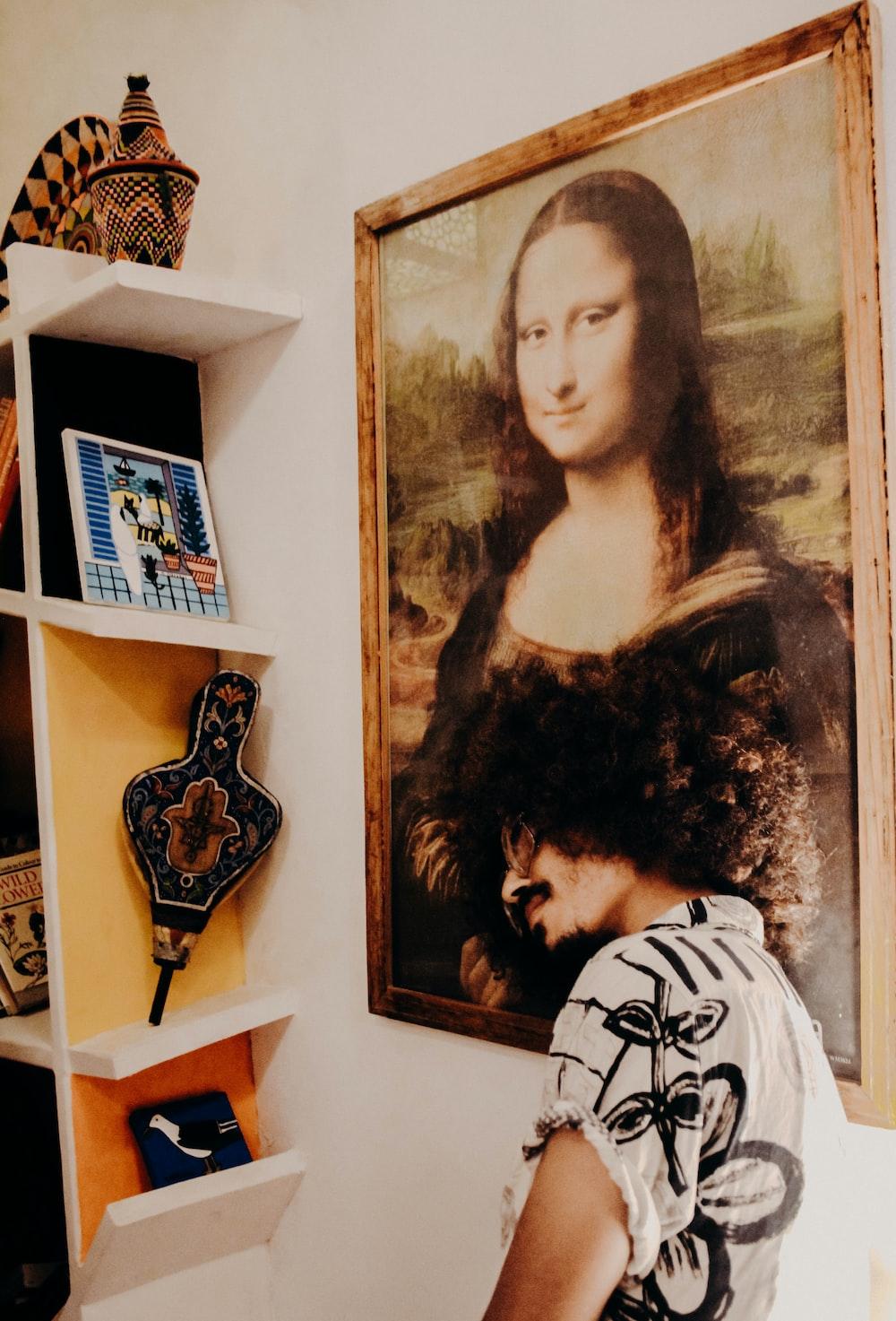 man standing near Mona Lisa painting