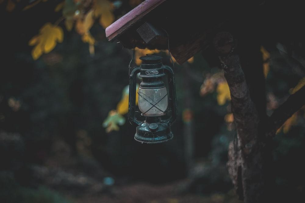 selective focus photography of black kerosene lamp