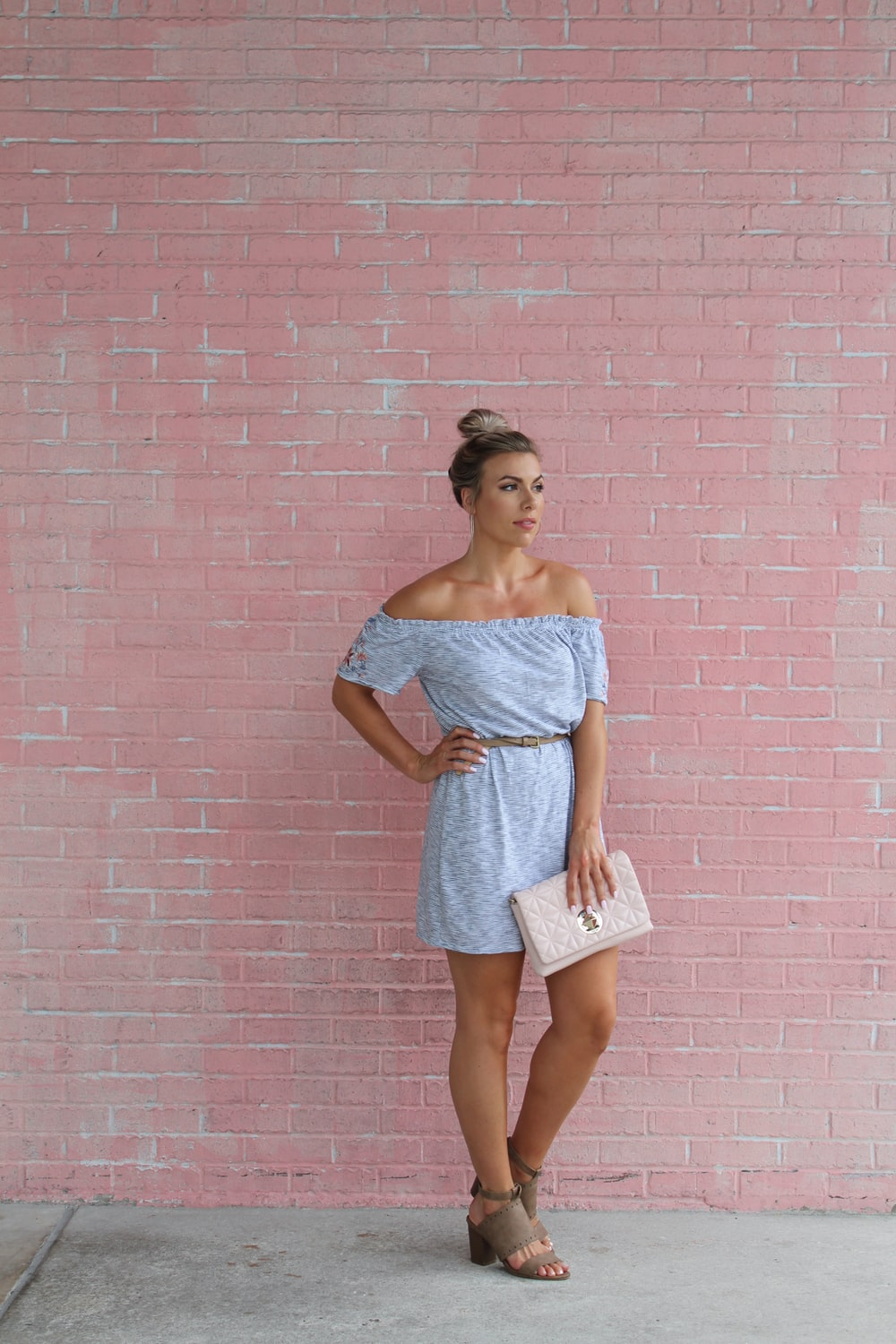 woman standing in front of pink wall