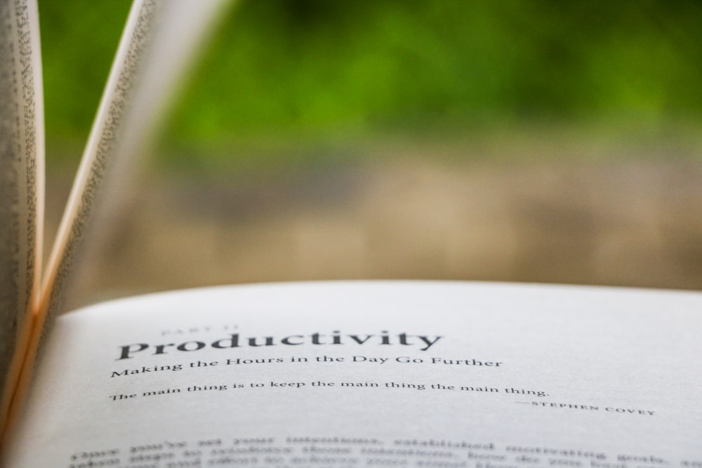 selective focus photography of Productivity printed book for pim workflow