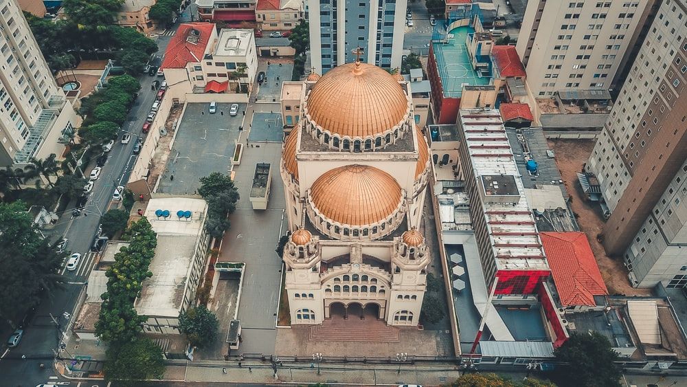 aerial photography of beige and white concrete building