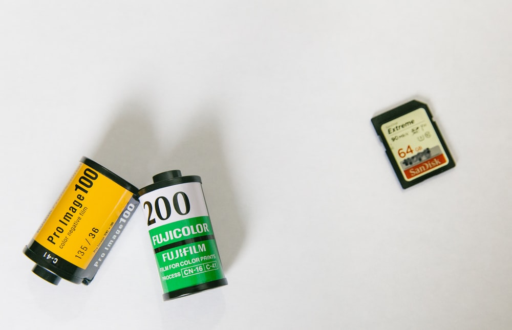 SanDisk adapter near two film cases