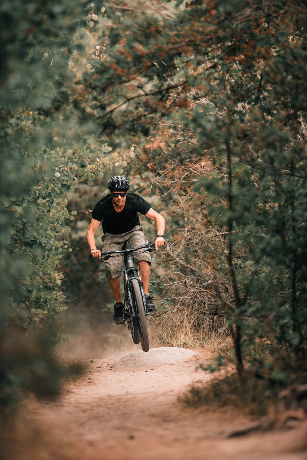 man on bike in downhill dirt road