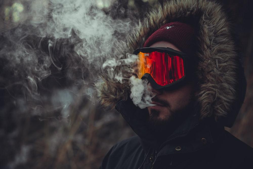 time lapse photography of man smoking