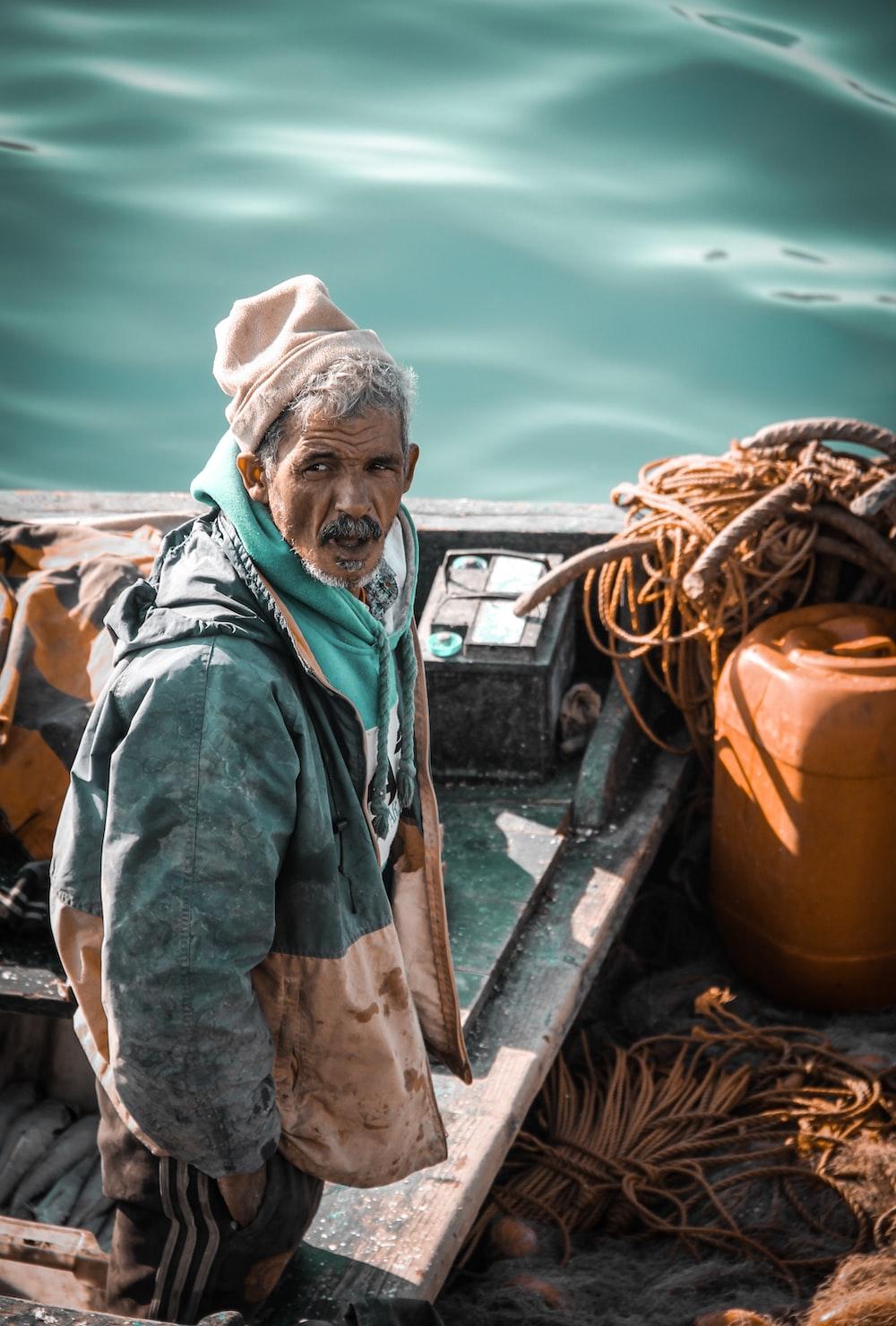 man standing on fishing boat