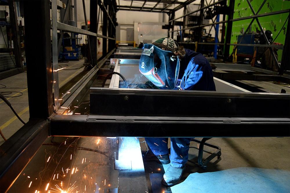 person welding metal