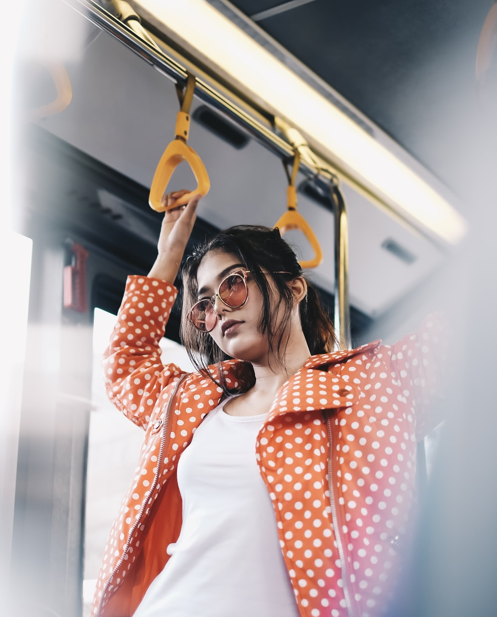 woman standing inside vehicle