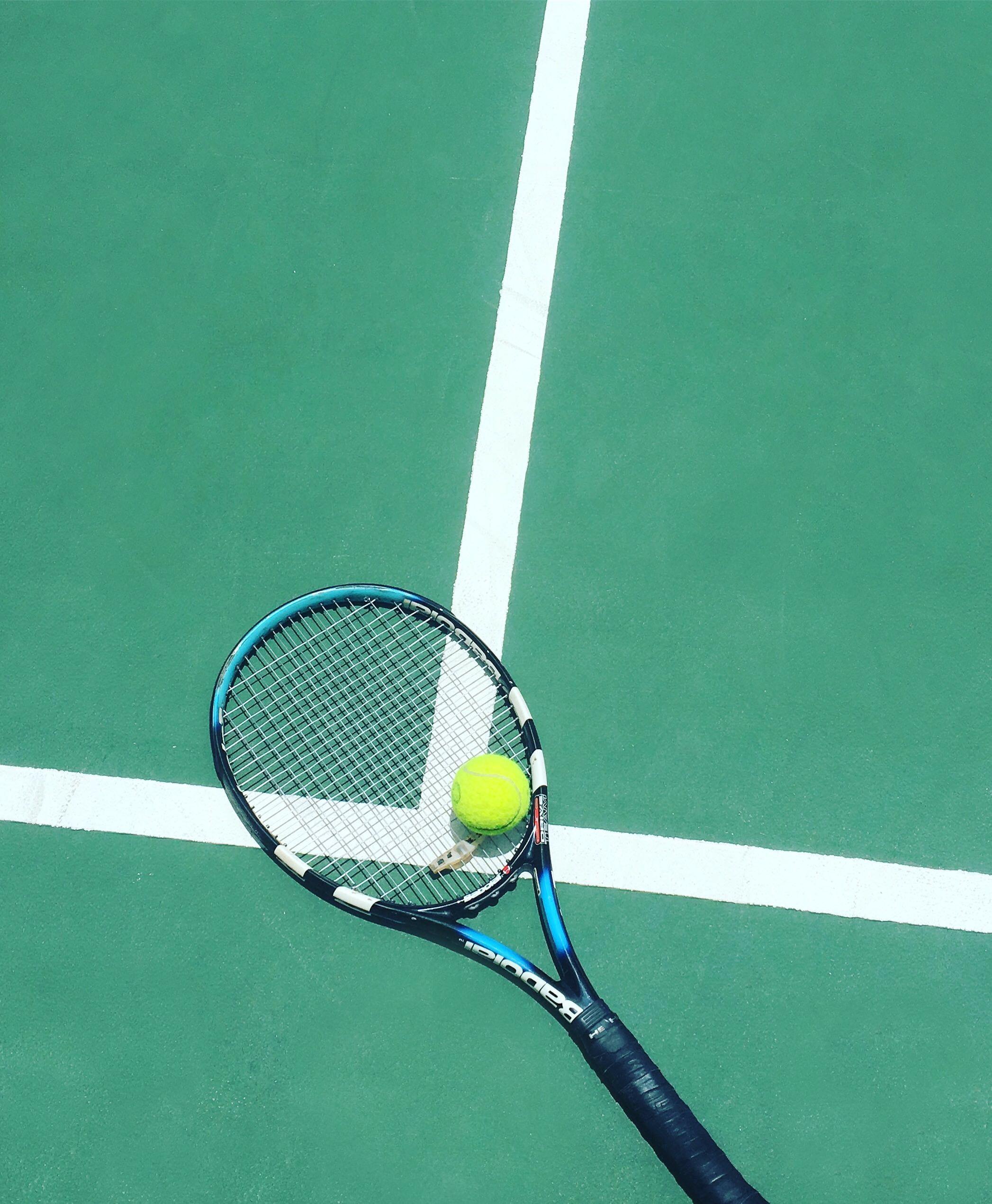 Tennis Racket And Ball On Field Photo Free Image On Unsplash