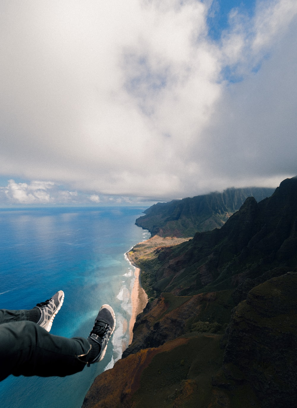 high angle photography of mountains beside ocean