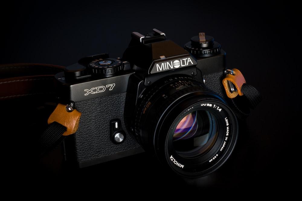 Minolta XD7 camera on black background