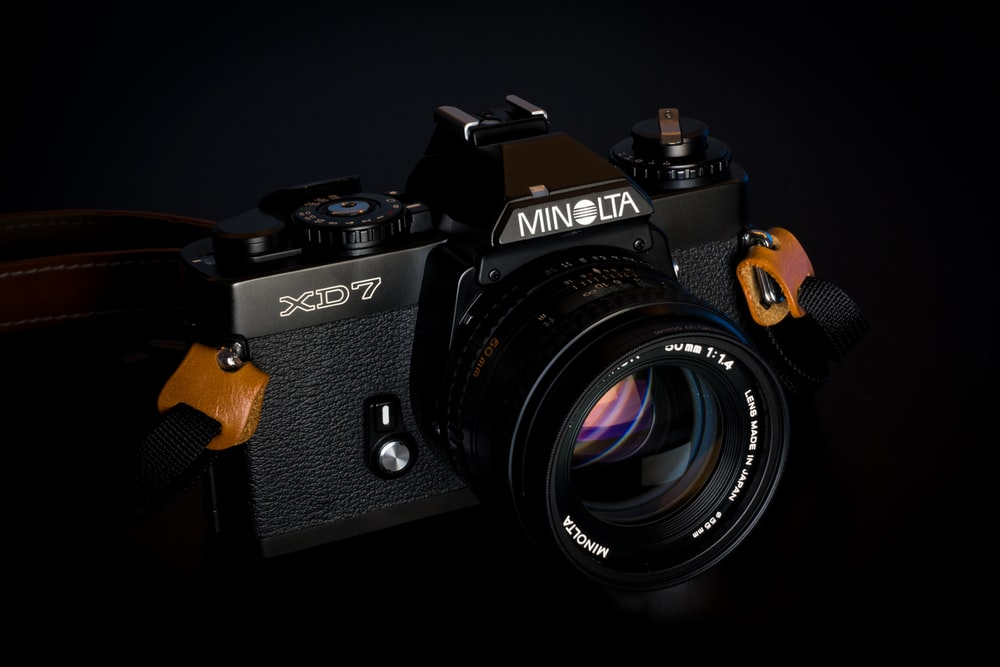 Minolta XD7 camera on black background