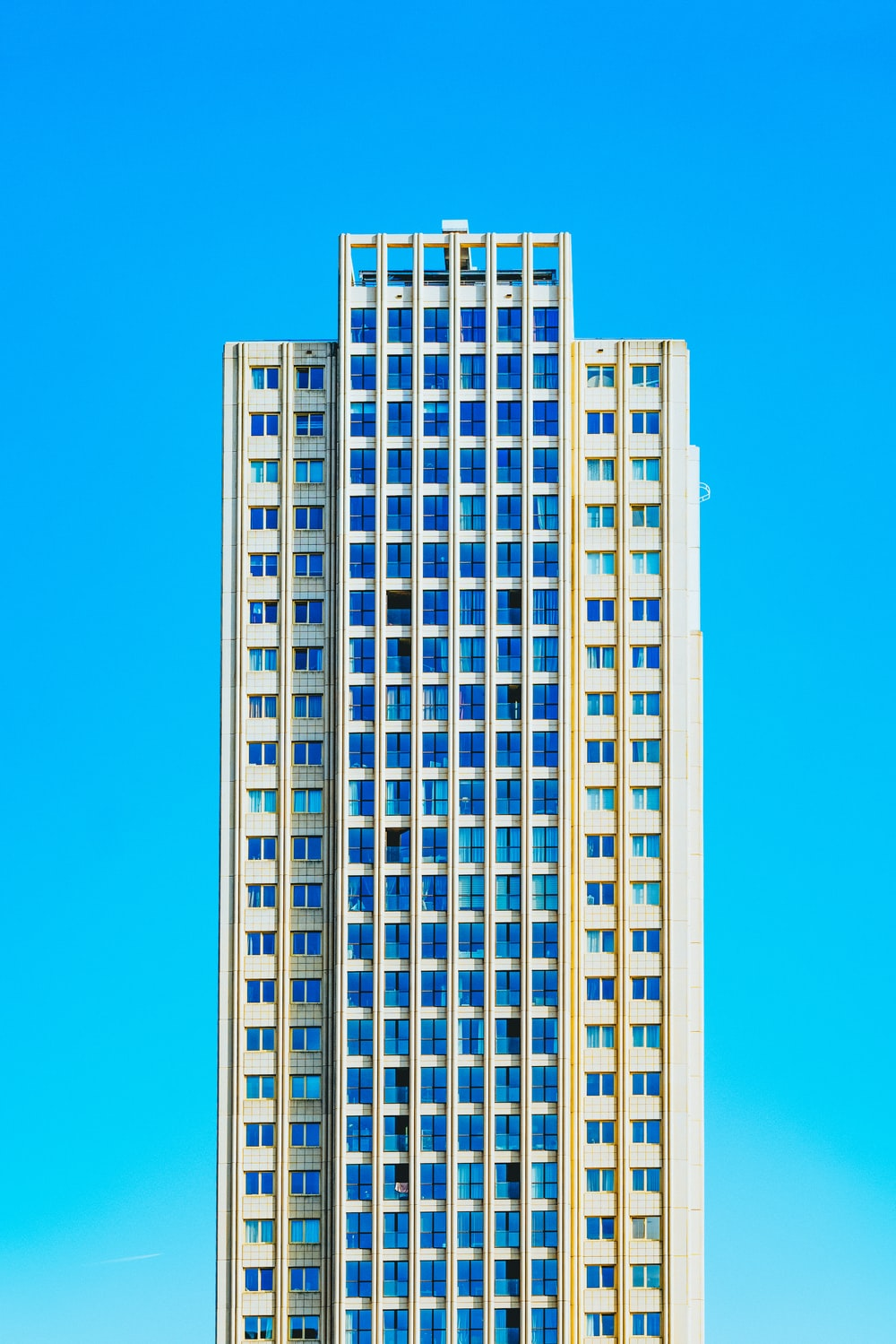 blue and beige high-rise buildings