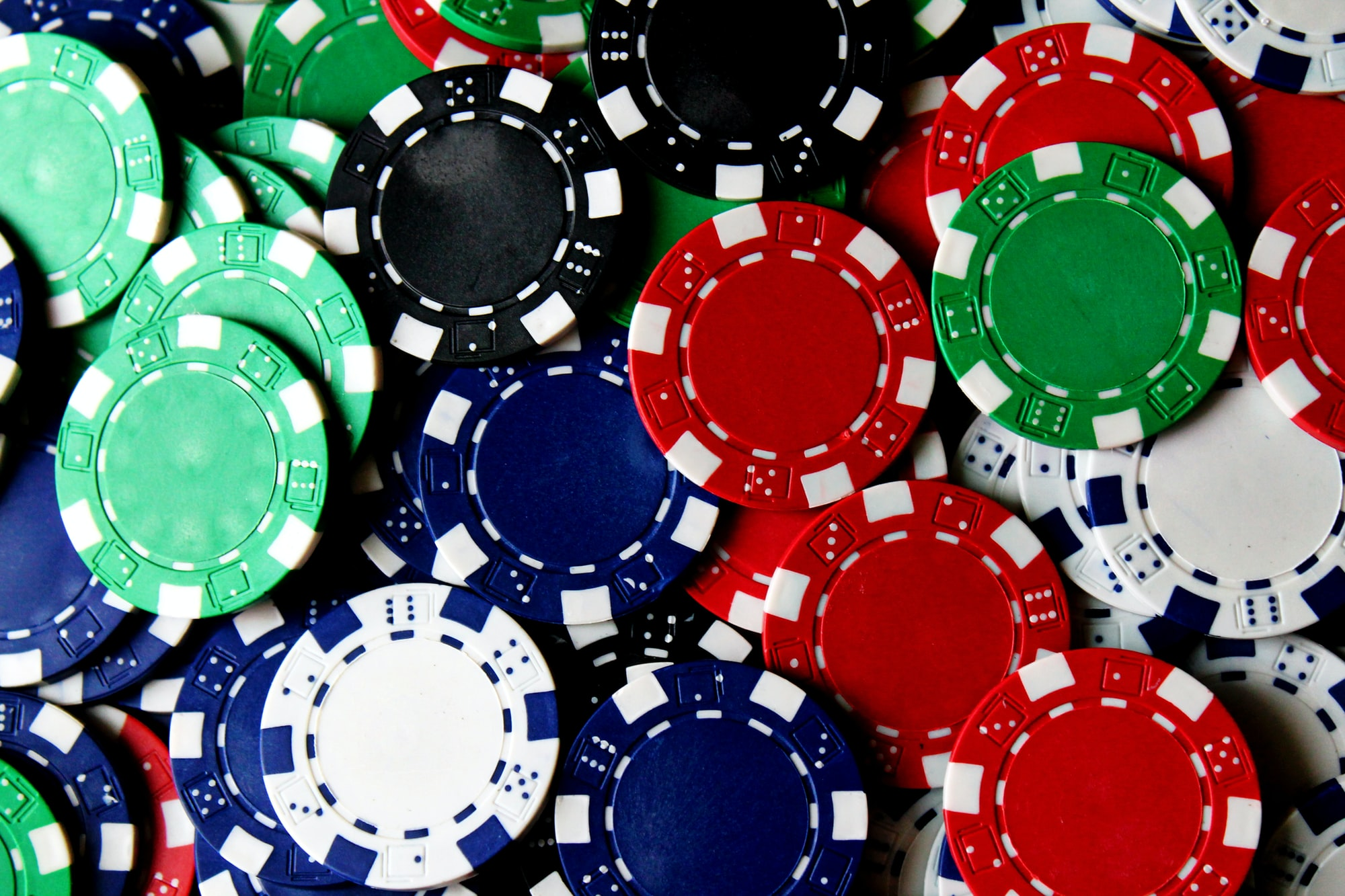A collection of poker chips in various colors.