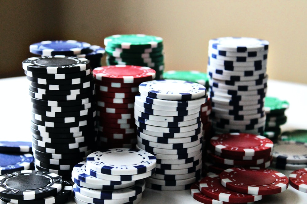 stacked poker chips with different colors