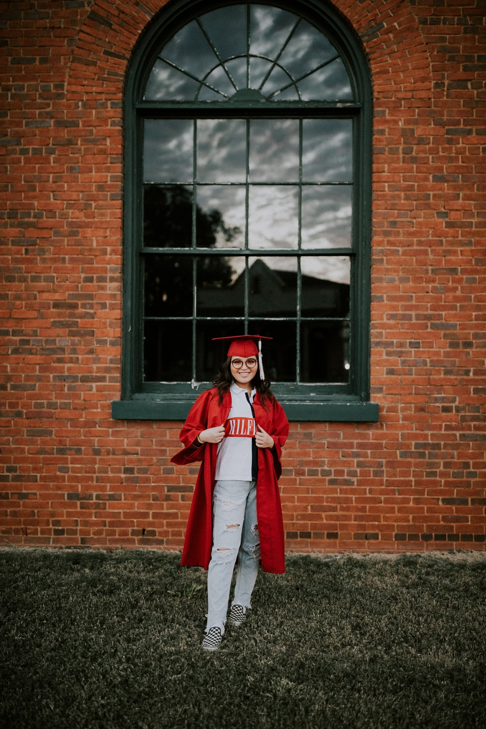 woman wearing academic dress and hat