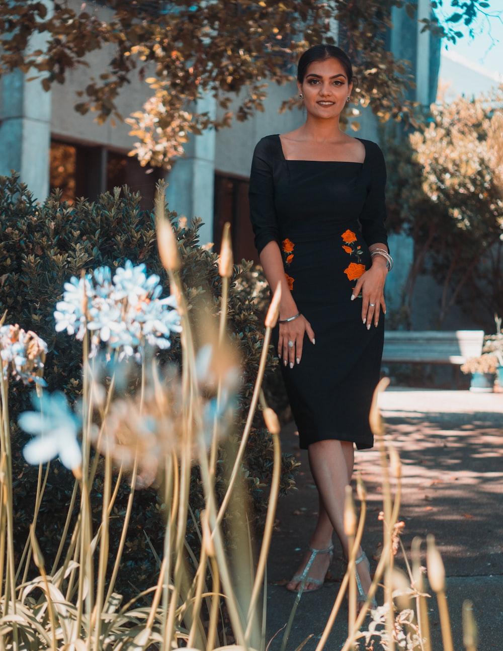woman standing ear plant