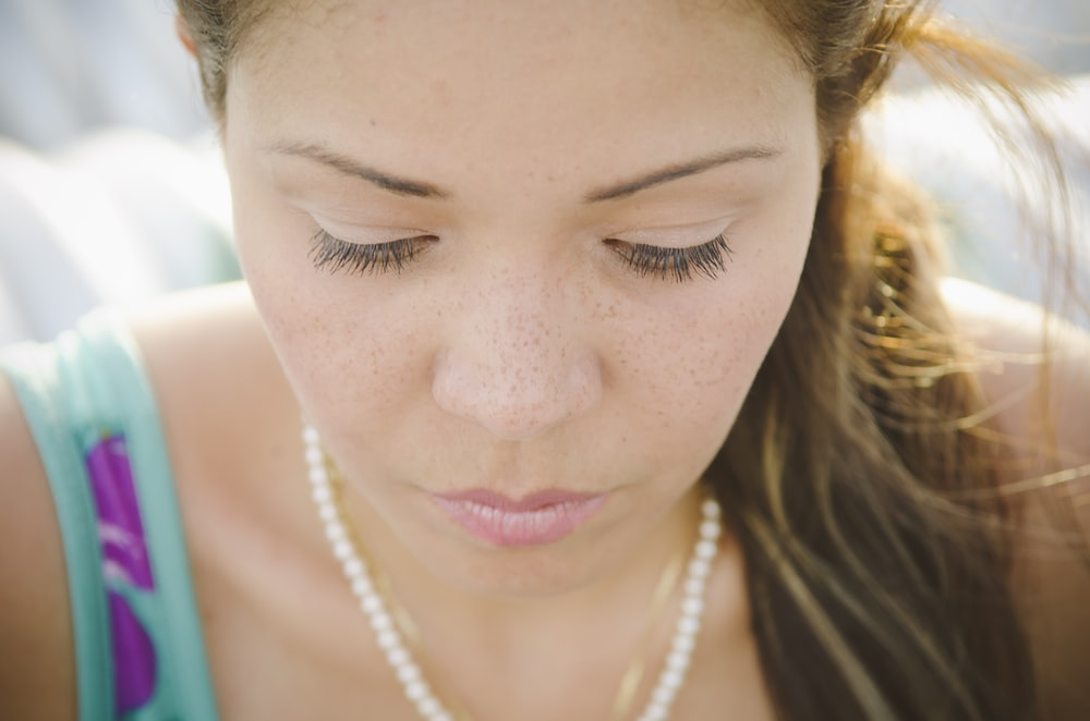 woman wearing beaded white necklace